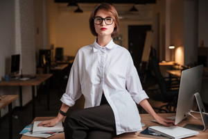Beautiful young businesswoman in glasses