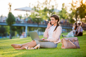 Beautiful Young Businesswoman Sitting In A Park On The Grass During A Lunch Break Checking Her Smartphone Sunny Summer Day Royalty Free Stock Image Storyblocks