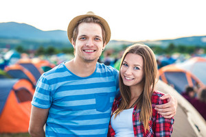 Beautiful young couple at summer tent festival