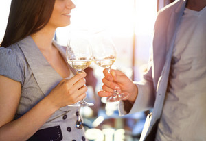 Beautiful young couple in love enjoying a glass of wine