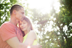 Beautiful young couple in love, hugging. Sunny summer nature.