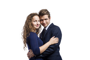 Beautiful young couple in love. Studio shot on white background