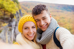 Beautiful young couple on a walk in autumn forest