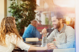 Beautiful young couple sitting in a cafe