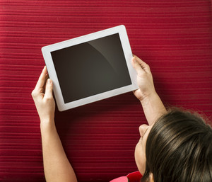 Beautiful young girl with blank white tablet
