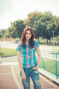 beautiful young hipster woman in the city