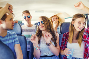 Beautiful young people on a road trip on a summers day