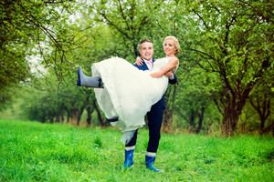 Beautiful young wedding couple outside in nature
