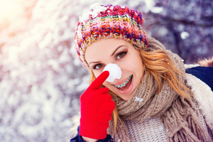 Beautiful young woman having fun outside in winter