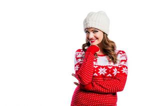 Beautiful young woman in red sweater. Studio shot on white background.