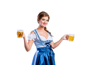 Beautiful young woman in traditional bavarian dress holding two mugs of beer. Oktoberfest. Studio shot on white background, isolated.