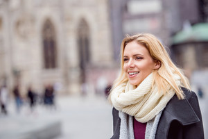 Beautiful young woman on a walk in historical centre of the city of Vienna, Austria. Winter.