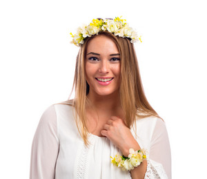 Beautiful young woman with a flower garland and a white dress isolated on a white background