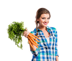 Beautiful young woman with carrots. Studio shot on white background.