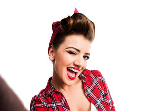 Beautiful young woman with pin-up make-up and hairstyle. Studio shot on white background