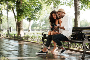 Beauty photo session in park. with pretty model and black man