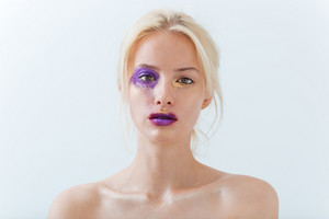 Beauty portrait of pretty young woman with fashion makeup