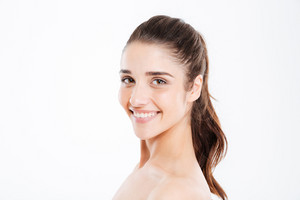 Beauty portrait of smiling young woman looking at camera over white background