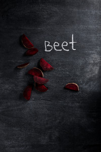 Beet over dark chalkboard background