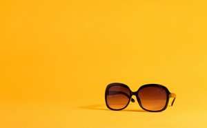 Big black sunglasses on a yellow background