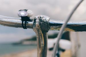 Bike handlebars close up on the beach after the rain