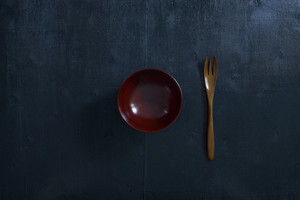 Black color wooden table top view. On the table are the Japanese wooden spoon.