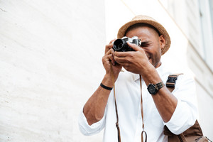 Black man photographs on the street