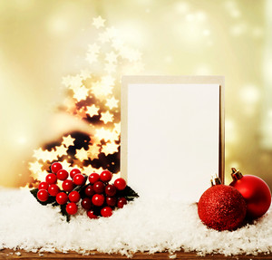 Blank card with red Christmas ornaments with star shaped lights on tree