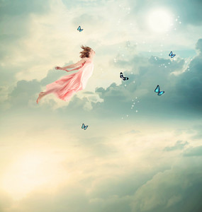 Blonde Girl Flying with Butterflies at Twilight
