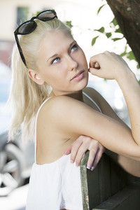 Blonde girl model with sunglesses outdoor