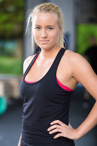 Blonde woman in workout outfit at the fitness gym