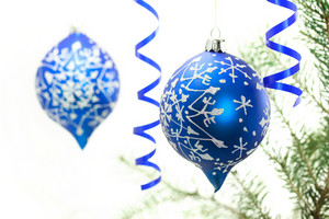 Blue Christmas ornaments on white background