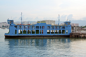 Blue ferry boat at the sea