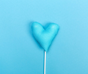 Blue heart cushion on a blue background