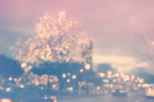 Blurred city scene background with traffic and trees