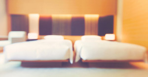 Blurred luxury hotel room with two queen beds