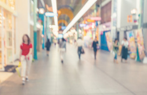 Blurred shopping mall corridor with people walking