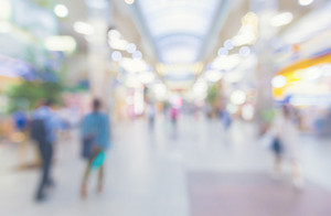 Blurred shopping mall interior with people walking