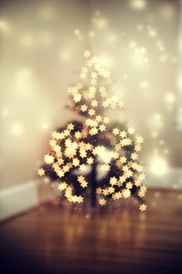 Blurred star shaped lights on a Christmas tree
