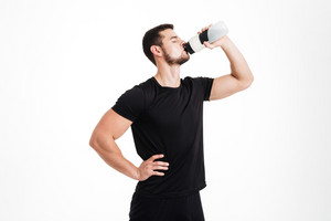 Bodybuilder drinking water. isolated white background
