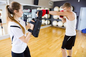 Boxer Punching Bag Held By Female Instructor