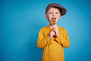 Boy licking lollipop
