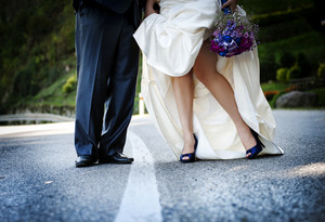 Bride and groom are walking outside together