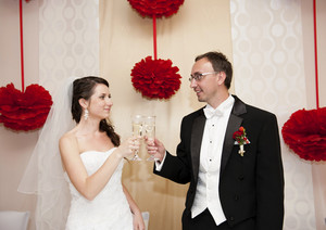 Bride and groom drinking champagne at the wedding recption