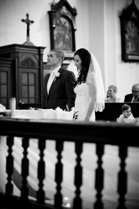 Bride and groom in church at the wedding day