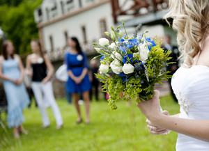 Bride is ready to throw away her wedding bouquet