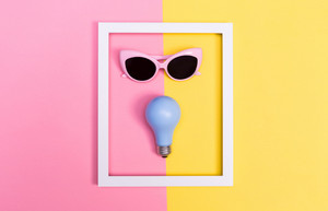 Bright light theme with painted lightbulb and sunglasses