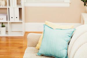 Bright living room interior with aqua sofa pillows