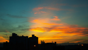 Building's silhouettes of a city and sunset.