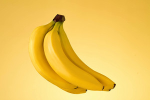 Bunch of bananas isolated on yellow background